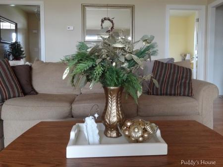 Christmas - Greens in Spraypainted vase-ornaments- wreath on mirror-foyer-tree-in-background