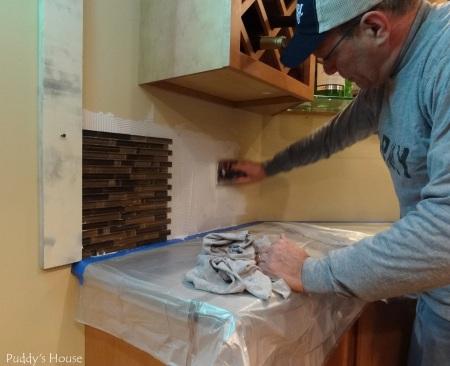 Bar Backsplash - Bob placing adhesive - first tile sheet in place