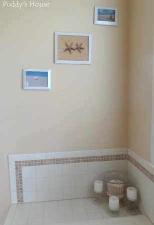 Master Bathroom - beach pictures and tub decor sand shells and candles