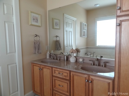 Master Bathroom - double sinks with thrifted art