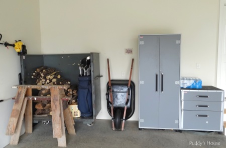 Garage - cabinets firewood and golf clubs organized